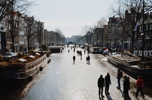 Ice-Skaters on Prinsengracht   Amsterdam Frozen Canals © Coupleofmen.com