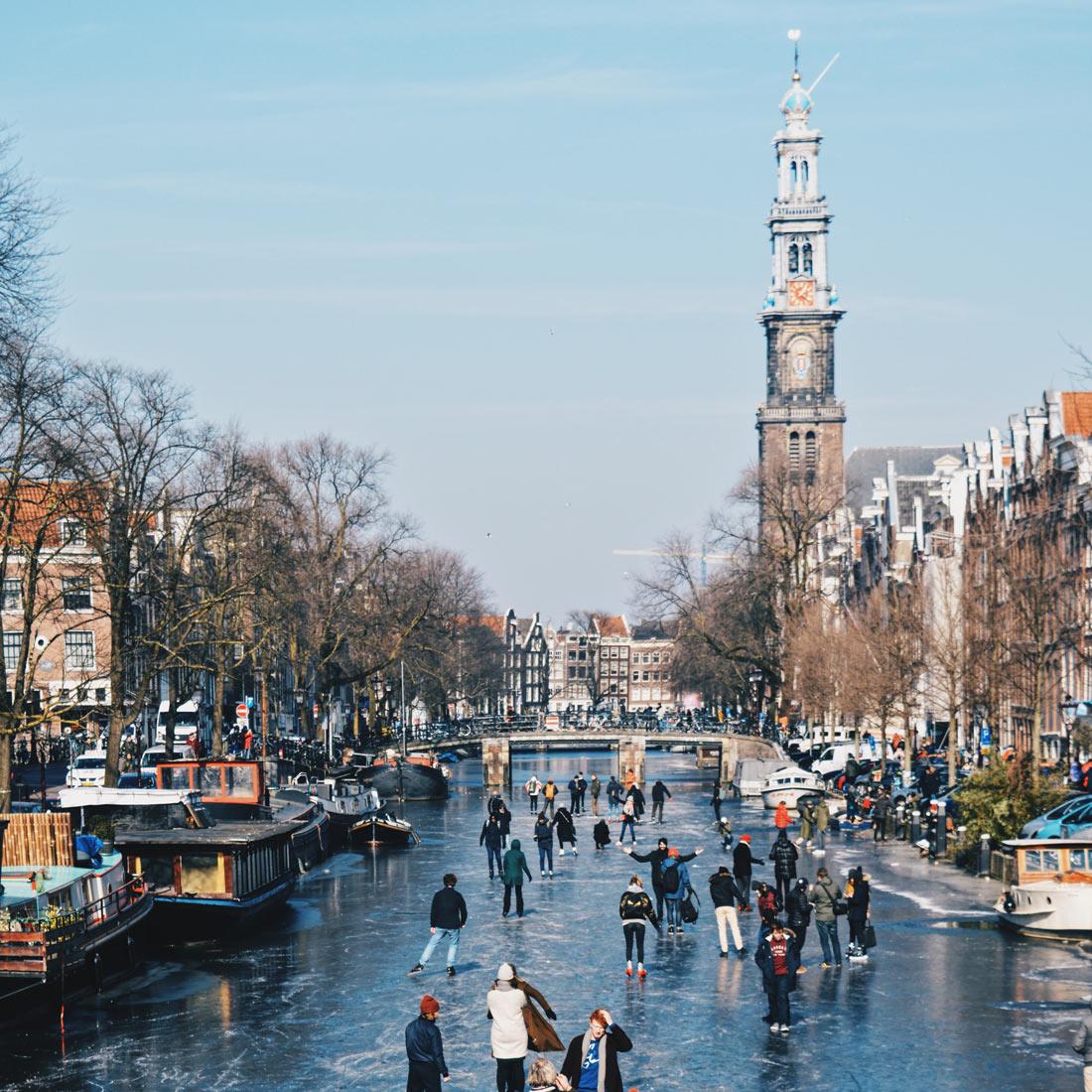 Winter on Amsterdam's frozen canals Frozen Prinsengracht with Westertoren   Amsterdam Frozen Canals © Coupleofmen.com