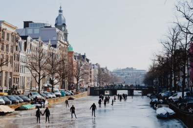 Ice Skaters on the Keizersgracht   Amsterdam Frozen Canals © Coupleofmen.com