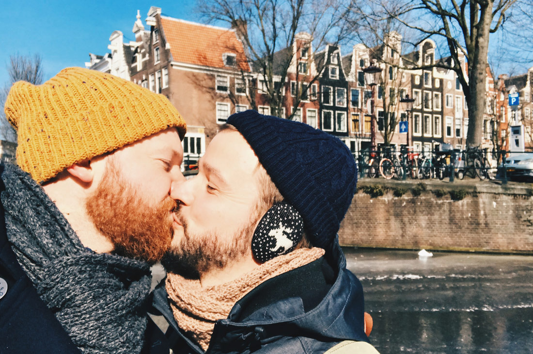 A Gay Couple's Kiss on Amsterdam Frozen Canals Ice Skating on Grachten © Coupleofmen.com