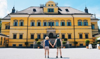 Gay Städtetrip Salzburg We as Gay Travelers hand-in-hand in front of the Hellbrunn Palace | Travel Salzburg Gay Couple City Trip © coupleofmen.com