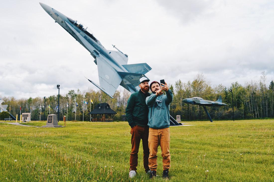 Gay Selfie in front of the Military Jets Memorial CFB Cold Lake | Road Trip Edmonton Northern Alberta © Coupleofmen.com
