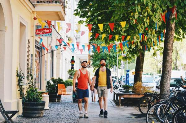 Berlin Gay Travel Guide Gay Couple hand-in-hand © Coupleofmen.com
