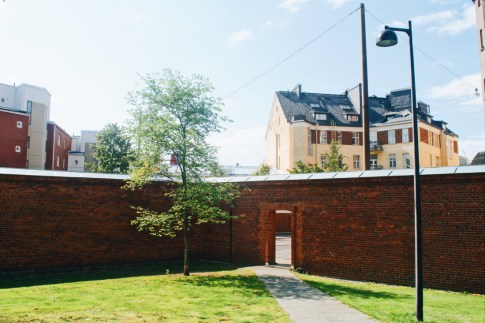 Well maintained prison garden always surrounded by the omnipresent brick wall | Katajanokka Hotel Helsinki Gay-friendly Review © Coupleofmen.com