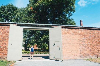 Daan standing in one of the prison gates | Katajanokka Hotel Helsinki Gay-friendly Review © Coupleofmen.com