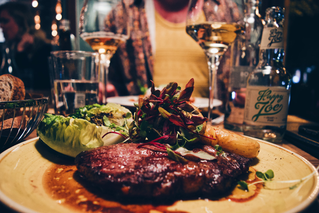 And a delicious Black Angus entrecôte with salad, roasted potatoes for Karl | Klaus K Hotel Helsinki Gay-friendly Tom of Finland Package © Coupleofmen.com