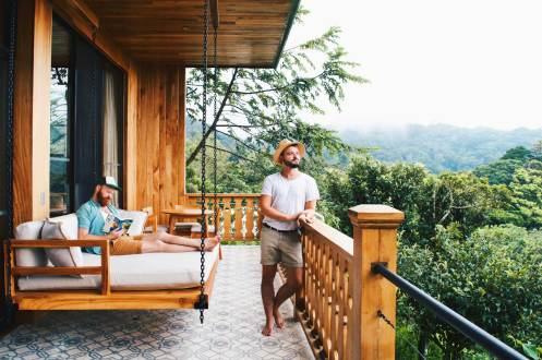 Gay Travel Guides 2018 Enjoying the view over the cloud forest Monteverde | Exploring Gay-friendly Costa Rica hand-in-hand together © Coupleofmen.com