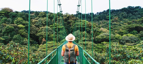 Gay Travel Journal Costa Rica Karl enjoying the stunning view over the Hanging Bridges in Monteverde | Gay-friendly Costa Rica © Coupleofmen.com