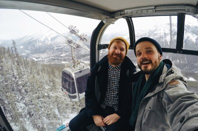 Karl & Daan inside a Banff Gondola Cabin | Winter Road Trip Alberta Highlights Canadian Rocky Mountains © Coupleofmen.com