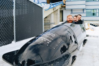 In a bobsled with Simon Dunn at Winsport   Winter Road Trip Alberta Highlights Canadian Rocky Mountains © Coupleofmen.com