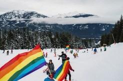 Whistler Pride Ski Festival Whistler Pride Gay Skiwoche Ski Parade downhill Whistler Mountain with uncountable rainbow flags during Whistler Pride and Ski Festival 2019 © Coupleofmen.com