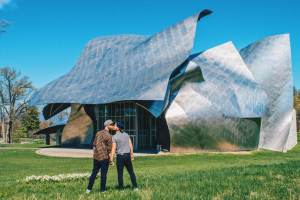 Gay Travel Dutchess County Hand-in-hand in front of the The Richard B. Fisher Center for the Performing Arts at Bard College designed by architect Frank Gehry © Coupleofmen.com