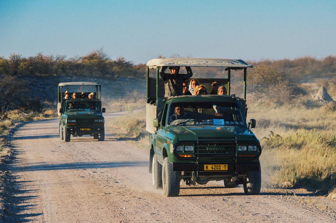 Game Drive Cars from the Mokuti Lodge on the gravel roads at Etosha in Namibia © Coupleofmen.com