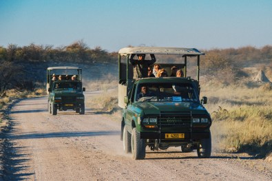 Game Drive Cars from the Mokuti Lodge on the gravel roads at Etosha in Namibia © Coupleofmen.com