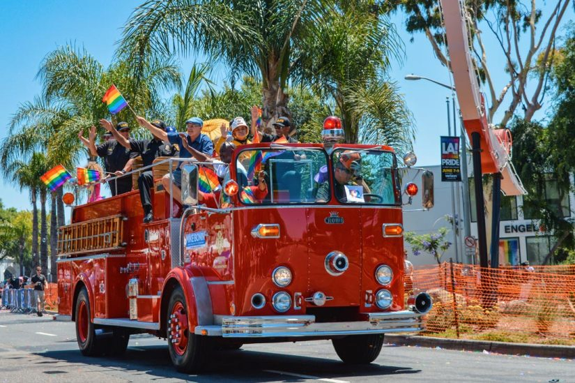 LA Fire Department supporting LA Pride in their red trucks on Santa Monica Boulevard © Coupleofmen.com