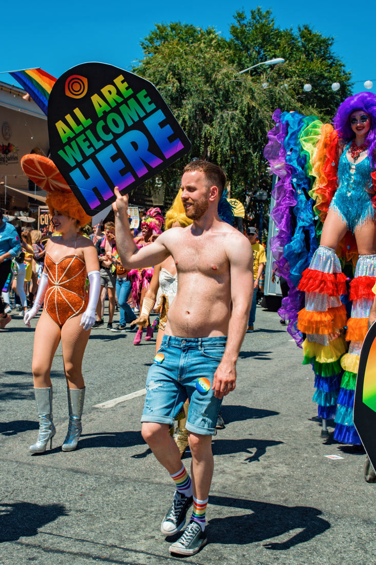 'All are welcome here' at Los Angeles Pride in West Hollywood even as half naked sex man in jeans © Coupleofmen.com
