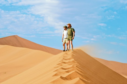 Standing on windy Dunes © Couple of Men Southern Africa Train Safari