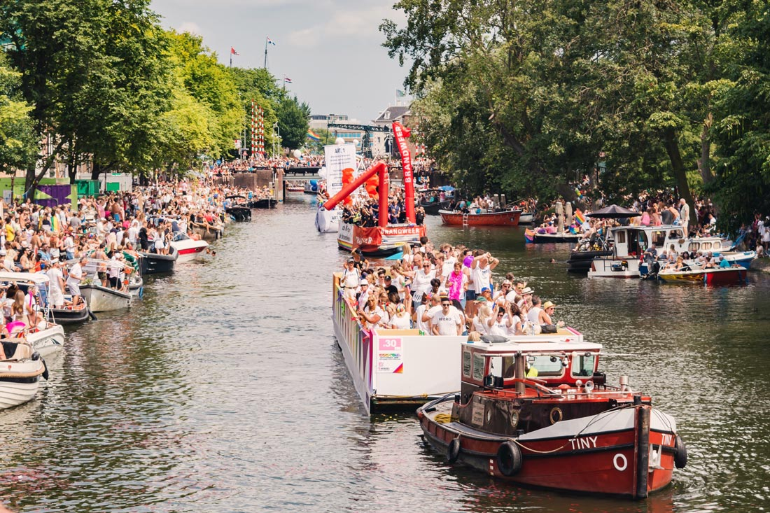 Pride Amsterdam 2018 from a Canal Parade Boat © Coupleofmen.com