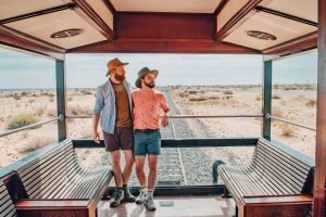 Enjoying the view from the Observation Deck at the end of the rain during our South African Train Safari © Coupleofmen.com