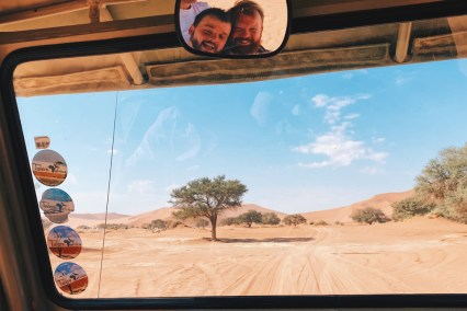 Fun selfie in the back mirrow during our drive to Sossusvlei area © Coupleofmen.com
