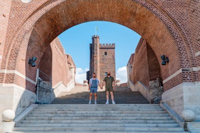 Gay Summer Road Trip Skåne Hand-in-hand on the Terrace stairs all the way up to Kärnan © Coupleofmen.com