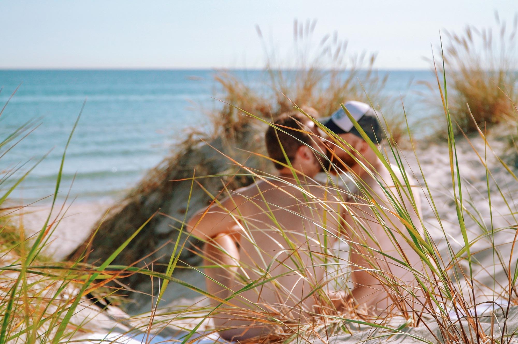 Gay Summer Road Trip Skåne A naked kiss at the clothing optional gay beach of Sandhammaren © Coupleofmen.com