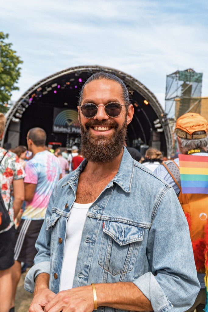 Gay Pride Malmö 2019 Handsome bearded man in jeans jacket at the LGBTQ+ festival at Folkets Park Malmö © Coupleofmen.com