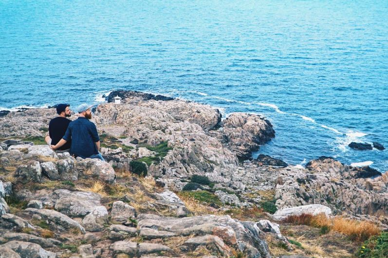 Gay Summer Road Trip Skåne Hand-in-hand in gay-friendly Southern Sweden overlooking the Kattegat shoreline © Coupleofmen.com