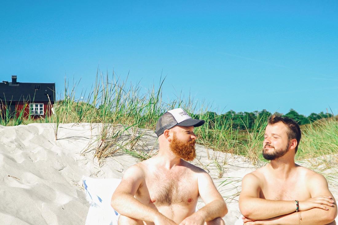 Gay Summer Road Trip Skåne Sunbathing together (naked) at the clothing optional gay beach of Sandhammaren © Coupleofmen.com