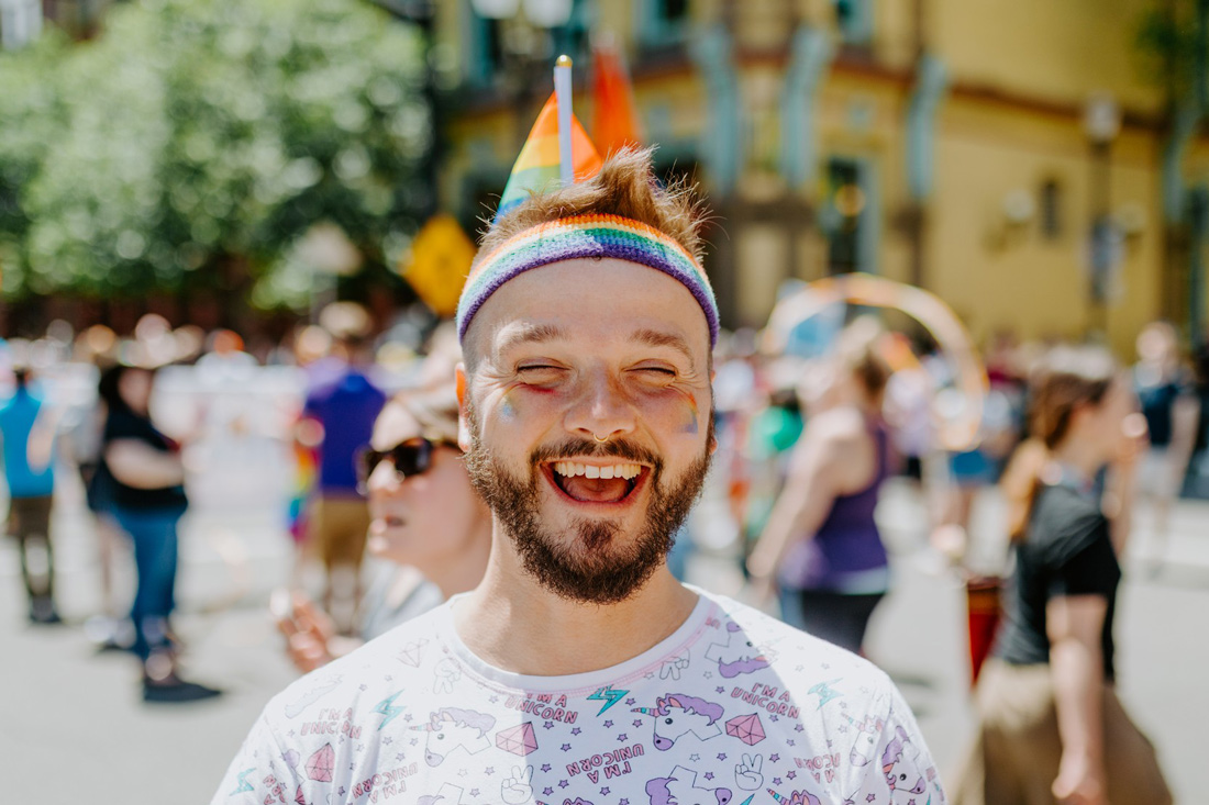 Karl dressed in his unicorn shirt with rainbow flags all over the place © Coupleofmen.com