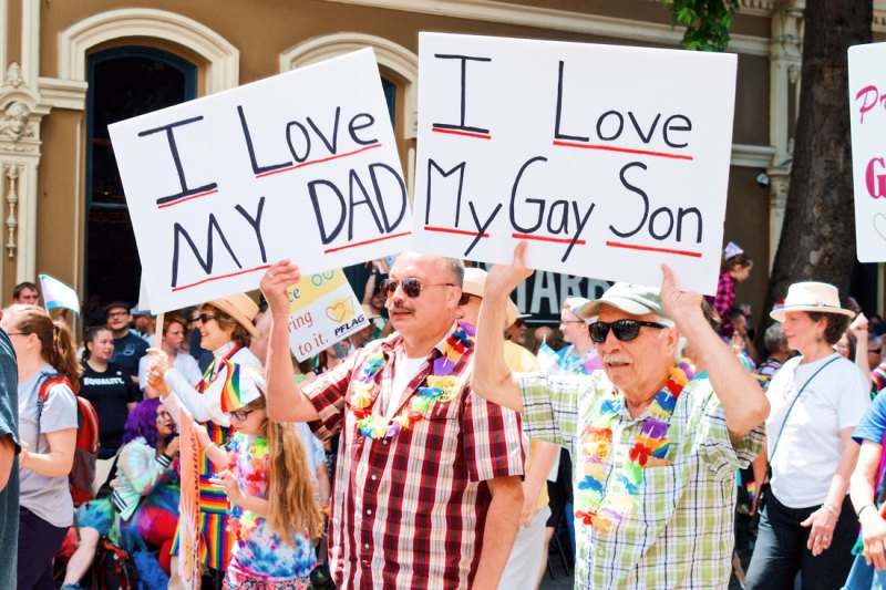 LGBTQ+ Pride: Pride LGBTQ+ rights Movement Proud son and a proud dad walking side by side © Coupleofmen.com