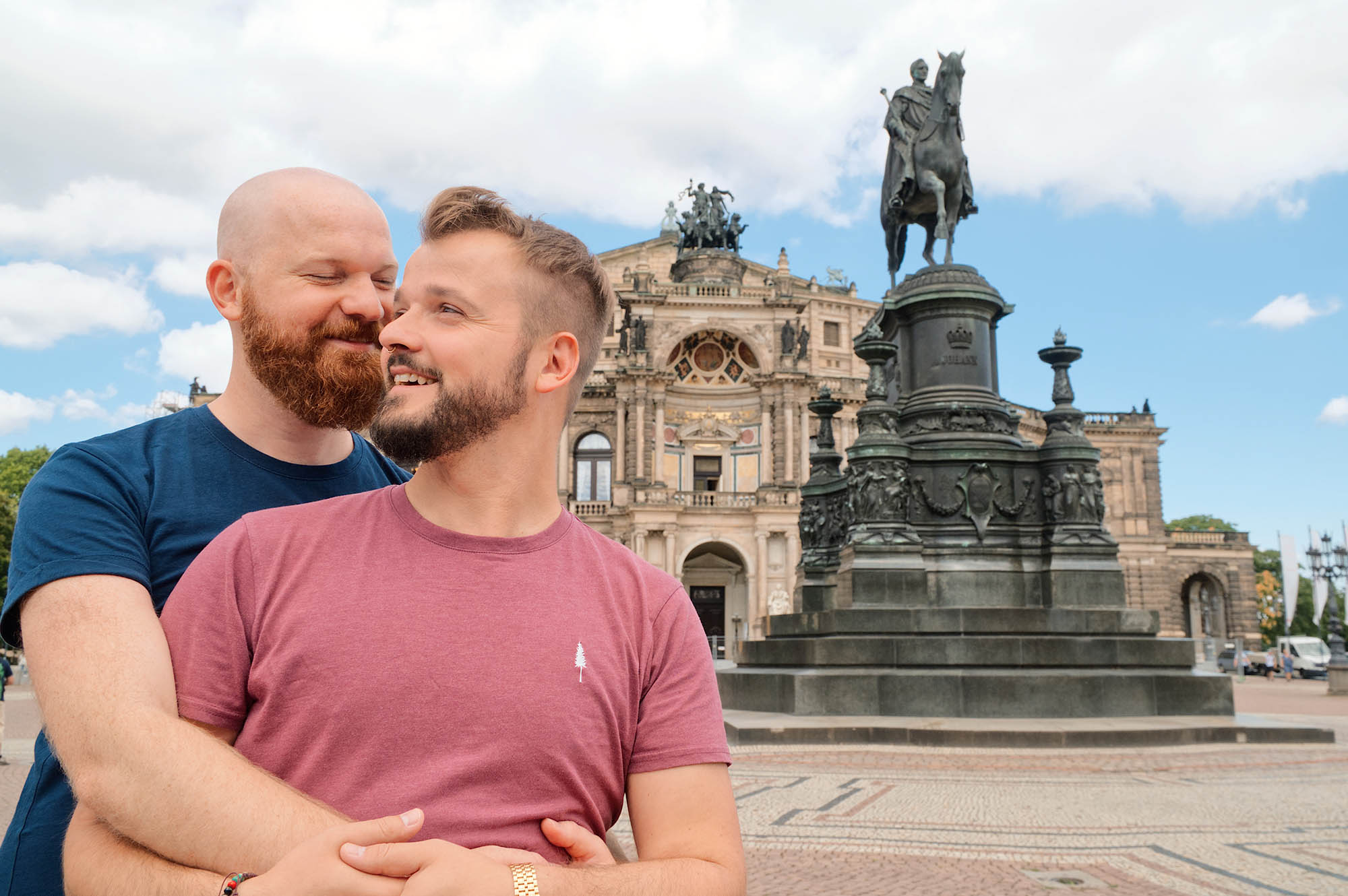 Dresden Gay City Trip: Gay Couple arm-in-arm in front of the Semper Opera © Coupleofmen.com