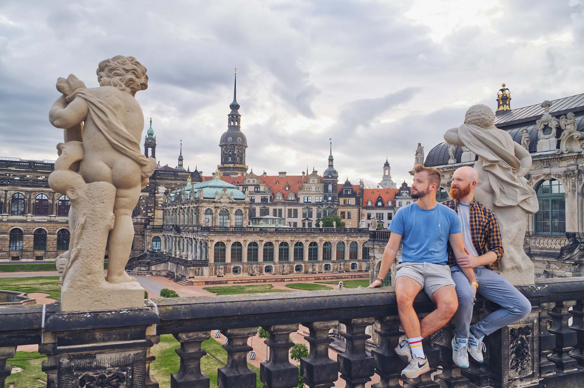 Dresden Gay City Trip: A Couple of Men enjoying the view over the historical old town city center in the Zwinger © Coupleofmen.com