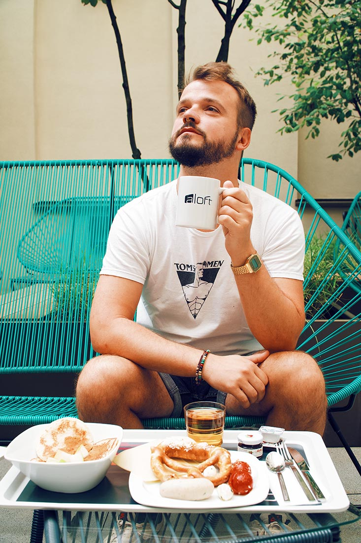 Karl loves a good morning coffee especially when served in the Aloft Munich coffee mug © Coupleofmen.com