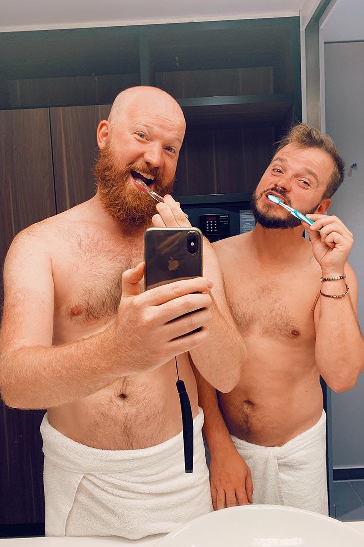 Bathroom fun - a couple of men brushing their teeth together - good morning Munich © Coupleofmen.com