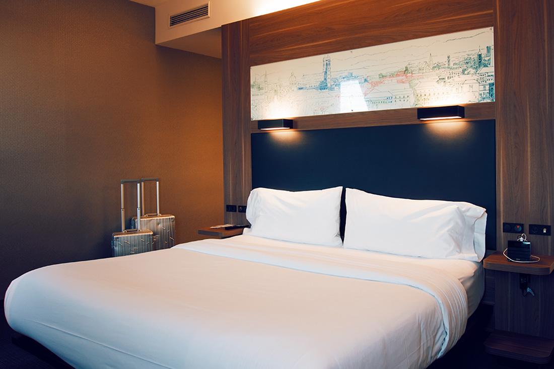 Super comfortable kingsize double-bed in our spacious loft room © Coupleofmen.com