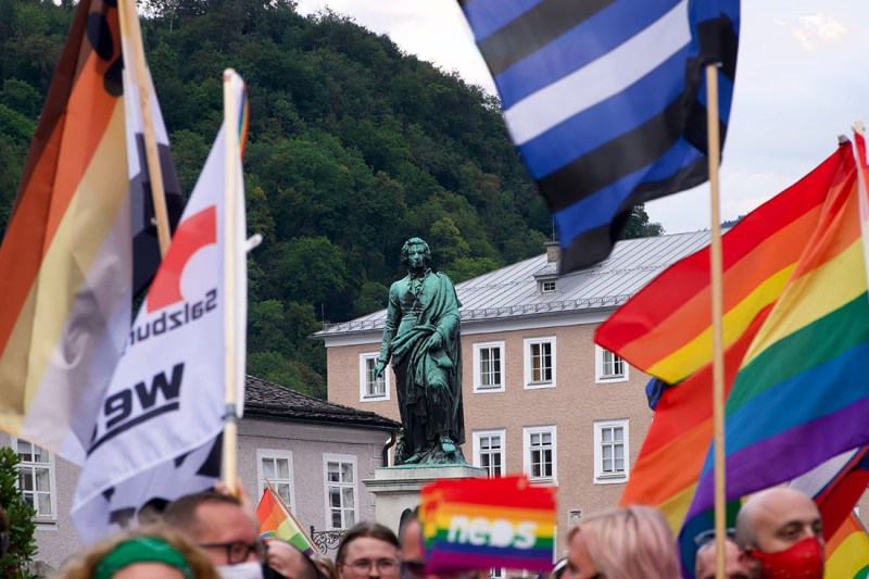 CSD Salzburg Pride Rainbow Pride Flags in front of Mozart statue © Coupleofmen.com