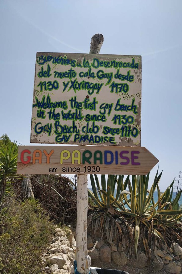 Colorful signs to Sitges Gay Beach Playa del Hombre Muerto