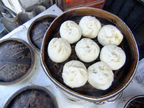 Steamed buns, filled with pork and leek, China