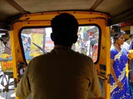 Fighting our way through crowds and traffic in an auto-rickshaw, Madurai, India