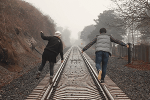 Two people on train track. Marriage Counseling Cincinnati, OH. 45226