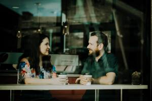Picture of a married couple listening to each other to illustrate the importance of good communication in a marriage. Cincinnati Marriage counseling.