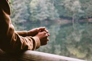 A picture of a person looking at a lake. CBT and Mindfulness Anxiety Treatment in Cincinnati, OH.
