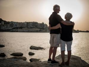 Photo of Retired Couple embracing by Lake | Cincinnati marriage counseling | Couples therapist in Cincinnati, OH 45226