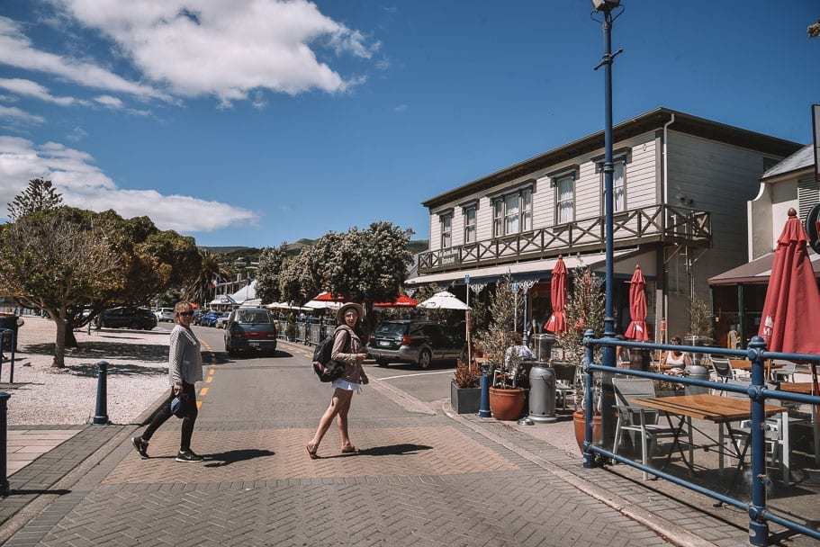 Akaroa-Wharf, Girls crossing at Akaroa Wharf, Akaroa, Akaroa-New-Zealand, Akaroa-Christchurch, Christchurch-day-trip, south-island-road-trip-itinerary, 2-week-new-zealand-itinerary, 7-day-south-island-itinerary