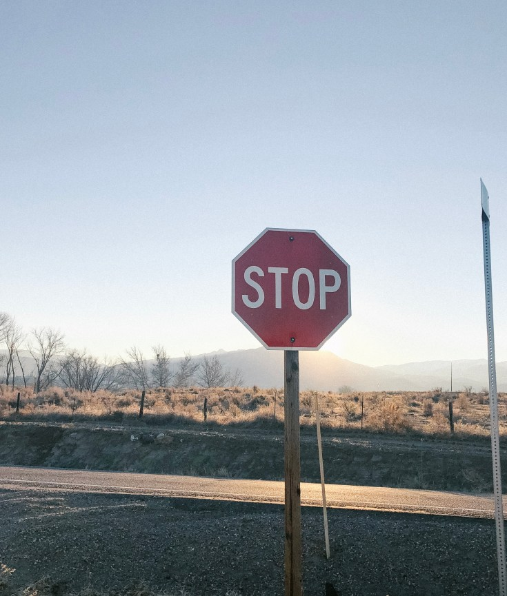 Stop sign in Melba Idaho with sun setting taken by courageously.u