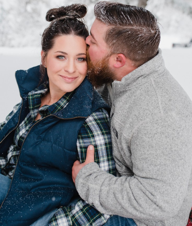 Engagement picture taken at Bogus Basin in a snow storm by glean and co