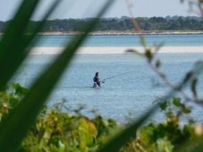 Pêcheur sur la plage de Fort Matanzas / St Augustine / Floride