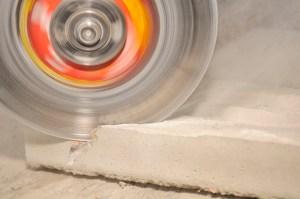 Grinder Cutting Concrete Block