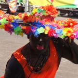 The black face paint and painted red lips are part of the traditional Son de Negro costume.